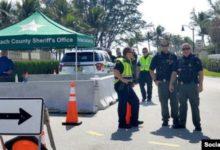 صورة اعتقال شخصين حاولا اختراق حاجزين قرب منتجع ترامب في فلوريدا
