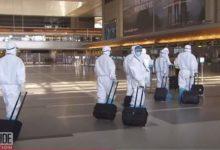 صورة بالفيديو.. مسافرون يرتدون بدلا واقية للانتقال من نيويورك إلى لوس أنجلوس خوفا من كورونا